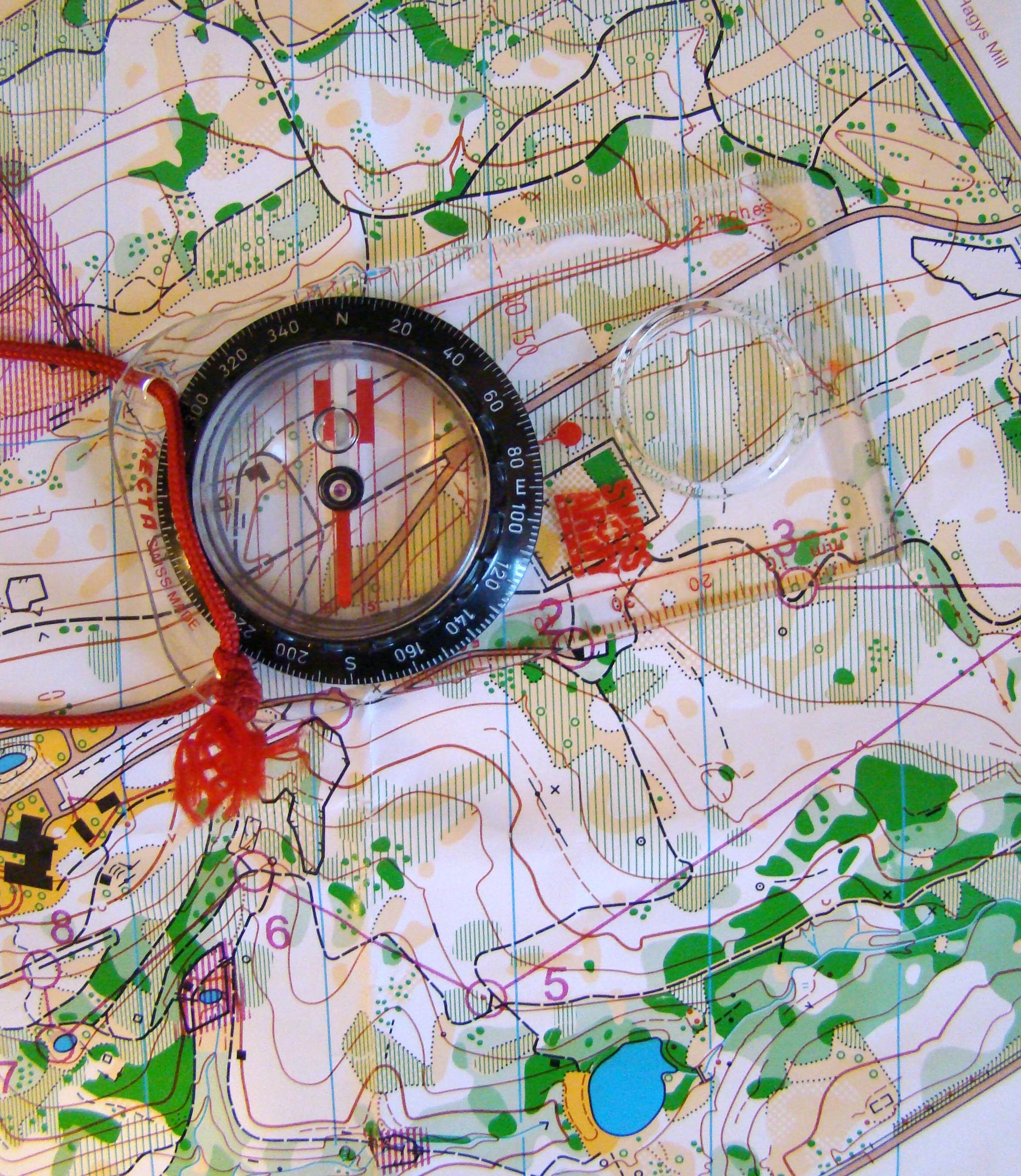 Besides our brains, the map and compass are the tools of orienteering.