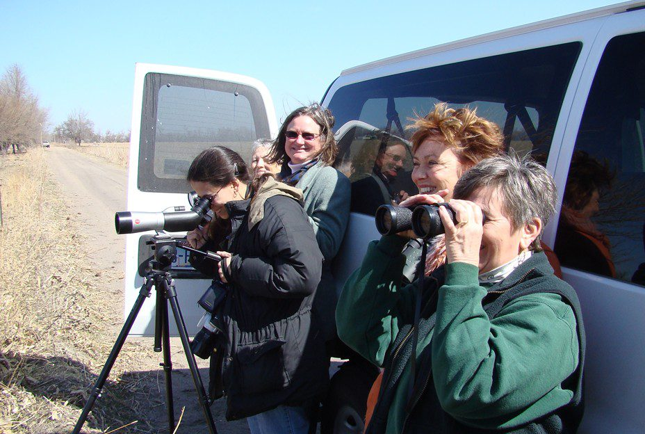 Five very happy participants looking at a Whooping Crane.  There are less than 300 of these birds in the wild.