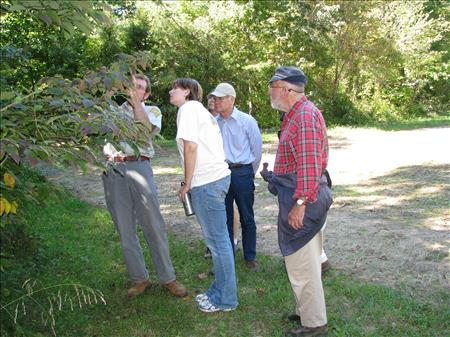 Kent County Forester, Bill Seybold, identifies a variety of trees in Blackbird State Forest.