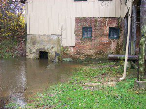Abbott's Mill outflow.  Note the submerged wall to the right of the bricks