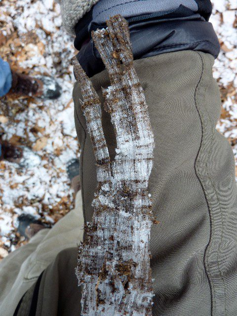 An ice column measure against Mike's arm.