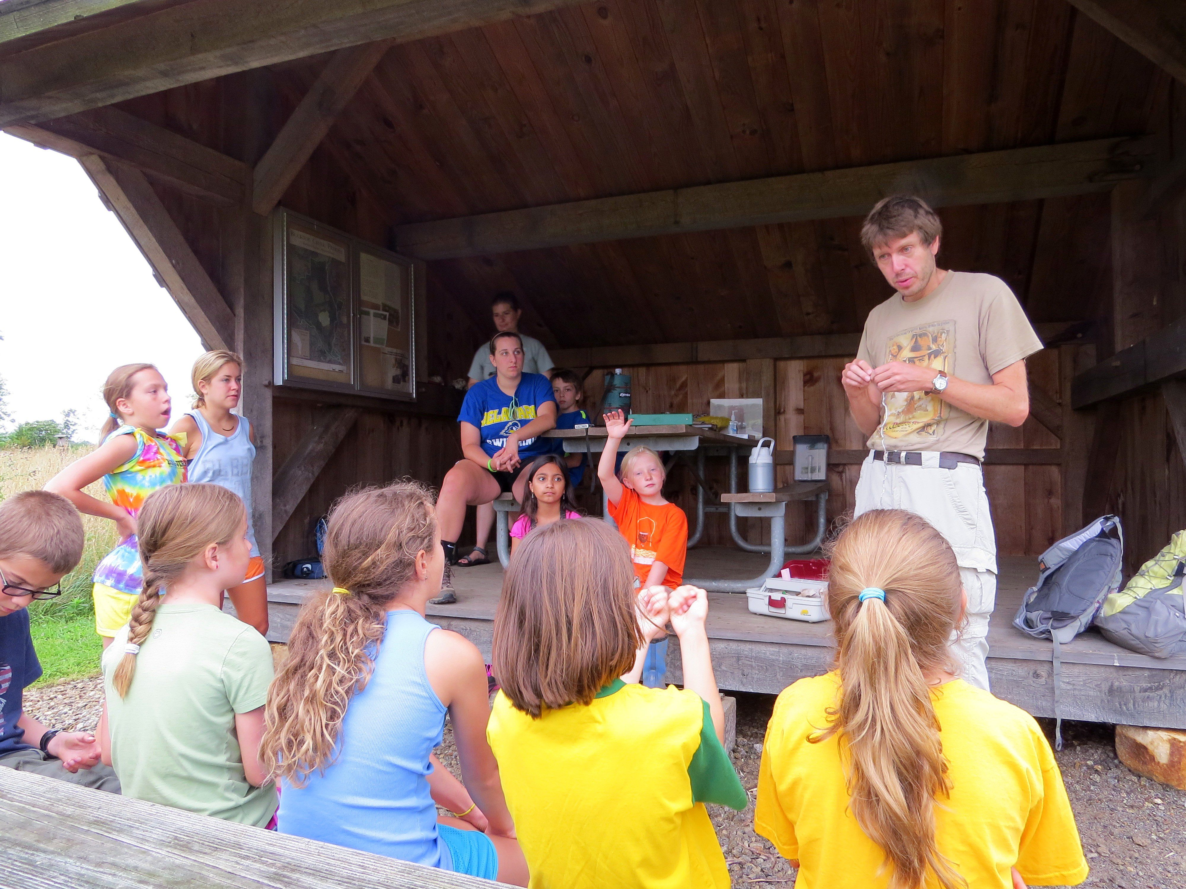 Ian is telling the group about his research banding Tree Swallows.